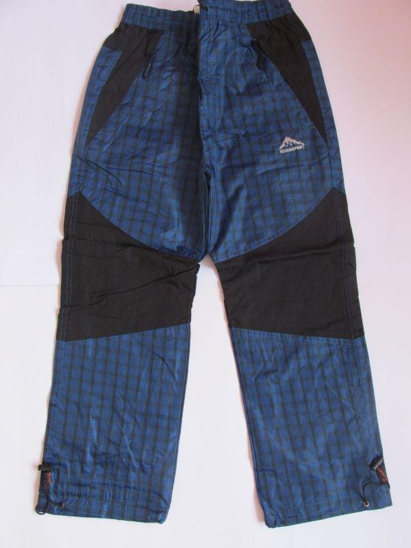 Šusťákové kalhoty Kugo s bavlněnou podšívkou modré