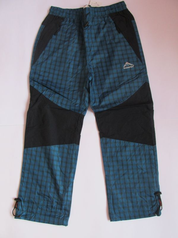 Šusťákové kalhoty Kugo s bavlněnou podšívkou petrolejové