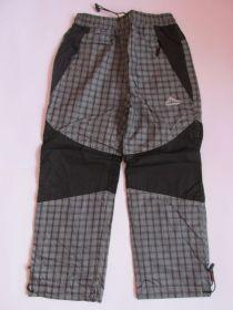 Šusťákové kalhoty Kugo s bavlněnou podšívkou šedé